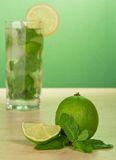 Mojito cocktail, slice of a lemon, and spearmint Royalty Free Stock Photos