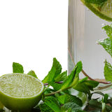 Mojito cocktail. Cocktail mojito with a slice of lime, mint and estragon in a glass with gas sparkles royalty free stock photography