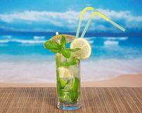 Mojito with cocktail straws and a lemon slice Stock Photos