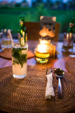 Mojito cocktail on the table. Mojito cocktail on the dinner table stock images