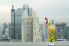 Mojito cocktail on table in rooftop bar Stock Images