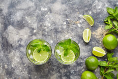 Mojito cocktail traditional alcohol bar drink top view copy space two highball glass, summer tropical freshness vacation Stock Photography