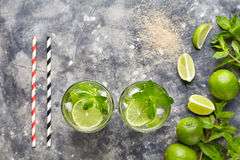 Mojito cocktail traditional alcohol bar drink top view copy space two highball glass, summer tropical vacation beverage Stock Photography