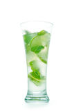 Mojito cocktail in wet misted glass. Green drink, lime, ice, foa. M and bubbles. Isolated on white, clipping path included Royalty Free Stock Images