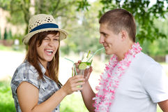 Mojito coctail. Cute couple drinking mojito coctail Royalty Free Stock Photography