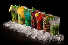 Mojito cold drink. Of different tastes on a black background Royalty Free Stock Photography