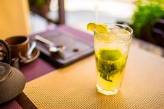 Mojito concept. Alcoholic drink put on table in restaurant close up stock photos