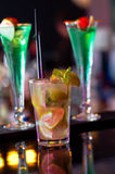 Mojito Between Cuba Libre. Mojito Drink between Cuba Libre drinks, served in a nightclub Stock Photo