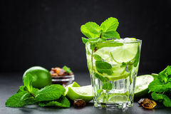 Mojito Cubano or caipirinha cocktail, iced drink with lime and mint Stock Photo