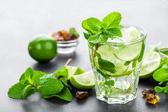Mojito Cubano or caipirinha cocktail, iced drink with lime and mint Royalty Free Stock Photo