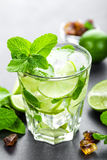 Mojito Cubano or caipirinha cocktail, iced drink with lime and mint Royalty Free Stock Image