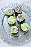 Mojito cupcakes. Chocolate cupcakes on silver flowery platter Stock Photo