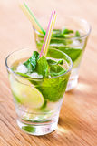 Mojito drink cocktail on the table. Cold mojito drink cocktail on the table Royalty Free Stock Photos