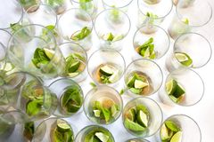 Mojito empty glasses with green leaves, sugar and lime stock photo