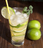 Mojito with fruit lime and ice. Royalty Free Stock Photography