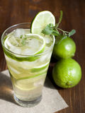 Mojito with fruit lime and ice. Royalty Free Stock Images