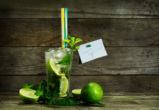 Mojito with ice on wooden background. Glass with Mojito and crushed ice on wooden background royalty free stock photos