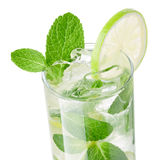 Mojito isolated on white closeup. Fresh mojito with limes and ice decorated with mint leaves isolated on white Stock Photos