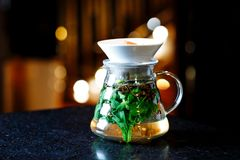 Mojito in a jug on a dark table stock photography
