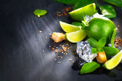 Mojito. Lime, mint, ice cubes and brown sugar Stock Photo