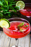 Mojito with lime and strawberry Stock Images
