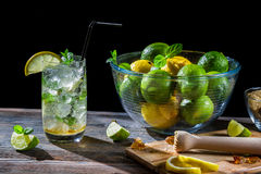 Mojito made ​​of fresh citrus. On black background royalty free stock images