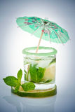 Mojito with mint and umbrella Stock Photography