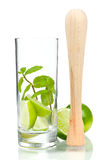 Mojito mix: lime, mint in glass and muddler Royalty Free Stock Photography