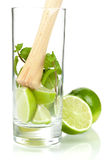 Mojito mix: lime, mint in glass and muddler Stock Images