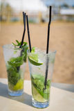 Mojito mohito freshness cocktail on a beach Royalty Free Stock Images