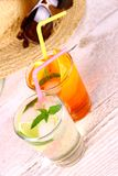 Mojito, orange cocktails with straw and holiday background Royalty Free Stock Image