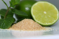 Mojito's ingredients. Photo of ingredients of mojito - lime, sugar and mint royalty free stock photo