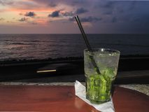 Mojito served at sunset royalty free stock photos