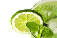 Mojito. Slice of lime in glass with ice and mint mojito royalty free stock photos