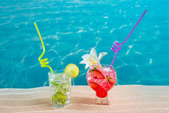 Mojito and strawberry cocktail on white sand beach Royalty Free Stock Image