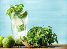 Mojito summer cocktail in tall glass with mint, brown sugar and limes Stock Photos