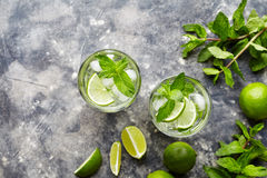 Mojito traditional Cuban cocktail non alcohol drink two highball glass, summer tropical vacation beverage with rum Royalty Free Stock Image
