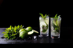 Mojito traditional summer refreshing cocktail alcohol drink in glass, bar preparation soda water beverage, lime juice Royalty Free Stock Image