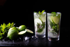 Mojito traditional summer vacation refreshing cocktail alcohol drink in glass, bar preparation soda water beverage, lime. Juice, mint leaves, sugar, and rum Stock Photo