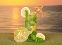 Mojito with umbrellas and lemon Stock Photos