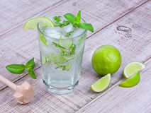Mojito on wooden background. Mojito cocktail on wooden background Royalty Free Stock Images