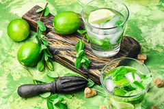 Mojitos cocktail with lime and mint leaves Stock Photography