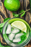 Mojitos cocktail with lime and mint leaves Stock Photo