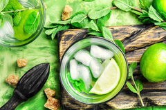 Mojitos cocktail with lime and mint leaves Stock Images