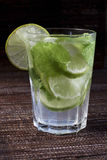Mojitos with mint leaves, lime and ice Royalty Free Stock Photography