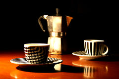 Moka coffee espresso. The italian coffee break. an old moka and 2 little cups Stock Photo
