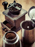 Moka express coffee maker and grinder Royalty Free Stock Image
