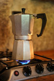 Moka pot. Brewing coffee on a stove Stock Photos