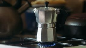 Moka pot brewing on a gas stove. Taditional way of brewing Italian coffee.