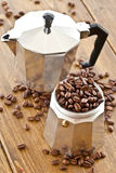 Moka pot and coffee beans Stock Photos